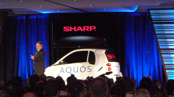 Sharp 80-inch TV on car at CES 2012.